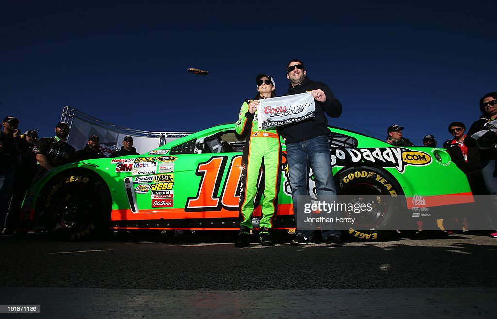 <a gi-track='captionPersonalityLinkClicked' href=/galleries/search?phrase=Danica+Patrick&family=editorial&specificpeople=183352 ng-click='$event.stopPropagation()'>Danica Patrick</a>, driver of the #10 GoDaddy.com Chevrolet, poses with team owner <a gi-track='captionPersonalityLinkClicked' href=/galleries/search?phrase=Tony+Stewart+-+Race+Car+Driver&family=editorial&specificpeople=201686 ng-click='$event.stopPropagation()'>Tony Stewart</a> holding the Coors Light Poll Award after qualifying for the NASCAR Sprint Cup Series Daytona 500 at Daytona International Speedway on February 17, 2013 in Daytona Beach, Florida.