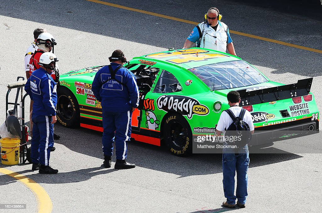 <a gi-track='captionPersonalityLinkClicked' href=/galleries/search?phrase=Danica+Patrick&family=editorial&specificpeople=183352 ng-click='$event.stopPropagation()'>Danica Patrick</a>, driver of the #34 GoDaddy.com Chevrolet, pulls into the garage area after a car malfunction during the NASCAR Nationwide Series DRIVE4COPD 300 at Daytona International Speedway on February 23, 2013 in Daytona Beach, Florida.