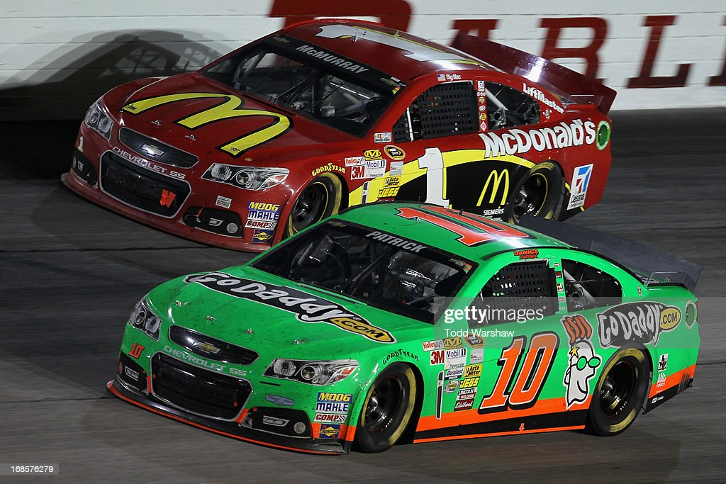 Danica Patrick, driver of the #10 GoDaddy.com Chevrolet, races Jamie McMurray, driver of the #1 McDonald's Chevrolet, during the NASCAR Sprint Cup Series Bojangles' Southern 500 at Darlington Raceway on May 11, 2013 in Darlington, South Carolina.
