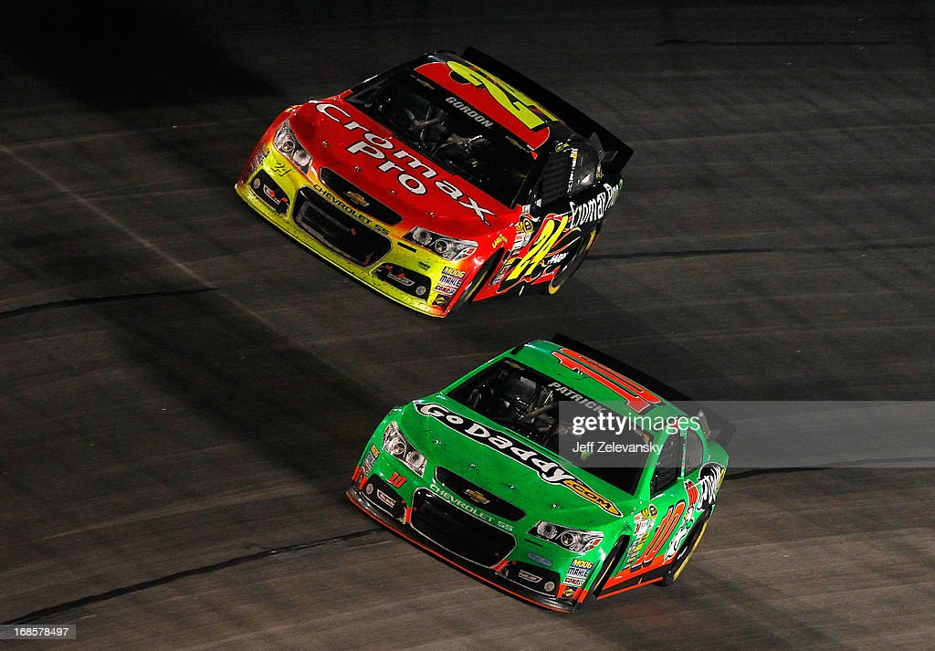 Danica Patrick, driver of the #10 GoDaddy.com Chevrolet, races with Jeff Gordon, driver of the #24 Cromax Pro Chevrolet, during the NASCAR Sprint Cup Series Bojangles' Southern 500 at Darlington Raceway on May 11, 2013 in Darlington, South Carolina.