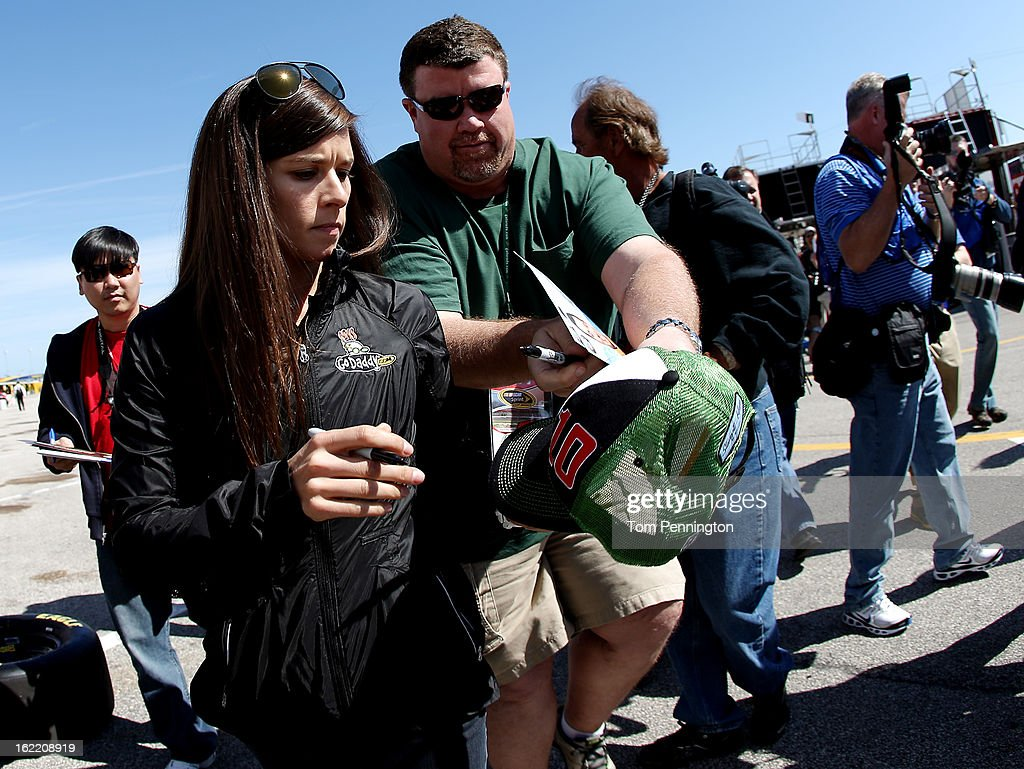 Danica Patrick, driver of the #10 GoDaddy.com Chevrolet, signs her autograph in the garage area during practice for the NASCAR Sprint Cup Series Daytona 500 at Daytona International Speedway on February 20, 2013 in Daytona Beach, Florida.