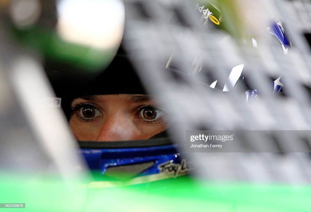 Danica Patrick, driver of the #10 GoDaddy.com Chevrolet, sits in her car in the garage during practice for the NASCAR Sprint Cup Series Daytona 500 at Daytona International Speedway on February 20, 2013 in Daytona Beach, Florida.