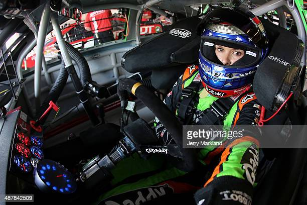Danica Patrick driver of the GoDaddycom Chevrolet sits in her car during practice for the NASCAR Sprint Cup Series Aaron's 499 at Talladega...