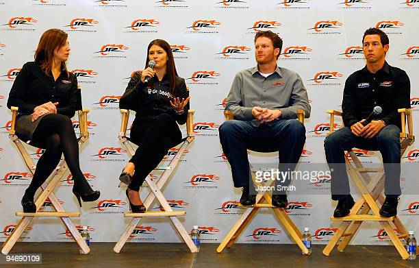 Danica Patrick driver of the GoDaddycom Chevrolet speaks as JR Motorsports Vice President and General Manager Kelly Earnhardt team owner Dale...