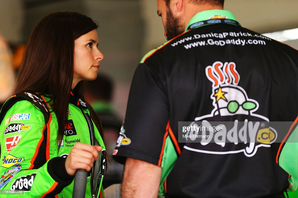 <a gi-track='captionPersonalityLinkClicked' href=/galleries/search?phrase=Danica+Patrick&family=editorial&specificpeople=183352 ng-click='$event.stopPropagation()'>Danica Patrick</a>, driver of the #10 GoDaddy.com Chevrolet, speaks with a crew member before practice for the NASCAR Sprint Cup Series Daytona 500 at Daytona International Speedway on February 22, 2013 in Daytona Beach, Florida.