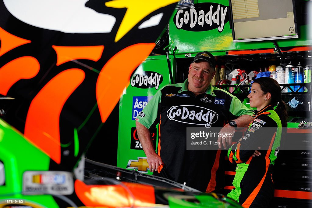 Danica Patrick, driver of the #10 GoDaddy.com Chevrolet, speaks with her crew chief Tony Gibson in the garage during practice for the NASCAR Sprint Cup Series Aaron's 499 at Talladega Superspeedway on May 2, 2014 in Talladega, Alabama.