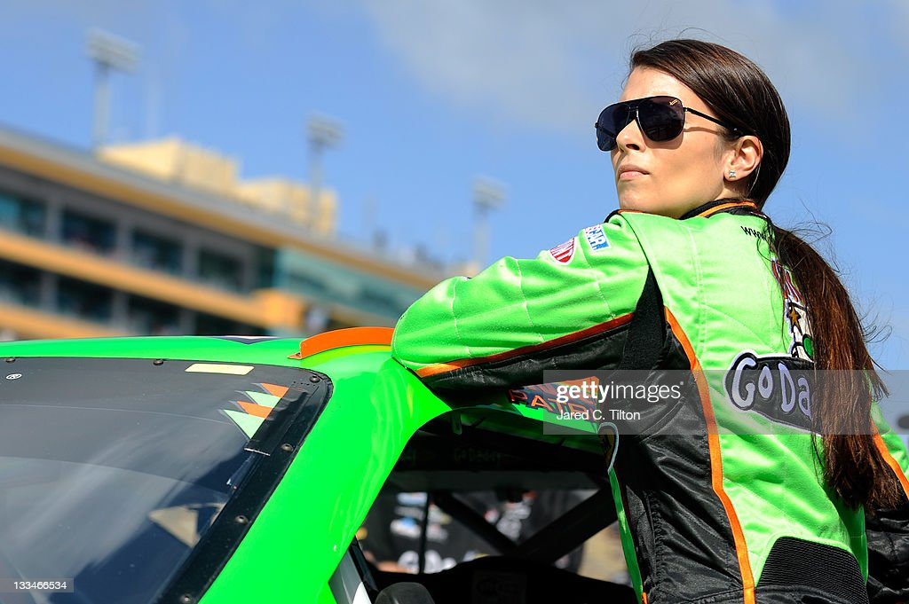 <a gi-track='captionPersonalityLinkClicked' href=/galleries/search?phrase=Danica+Patrick&family=editorial&specificpeople=183352 ng-click='$event.stopPropagation()'>Danica Patrick</a>, driver of the #7 GoDaddy.com Chevrolet, stands by her car on the grid during qualifying for the NASCAR Nationwide Series Ford 300 at Homestead-Miami Speedway on November 19, 2011 in Homestead, Florida.