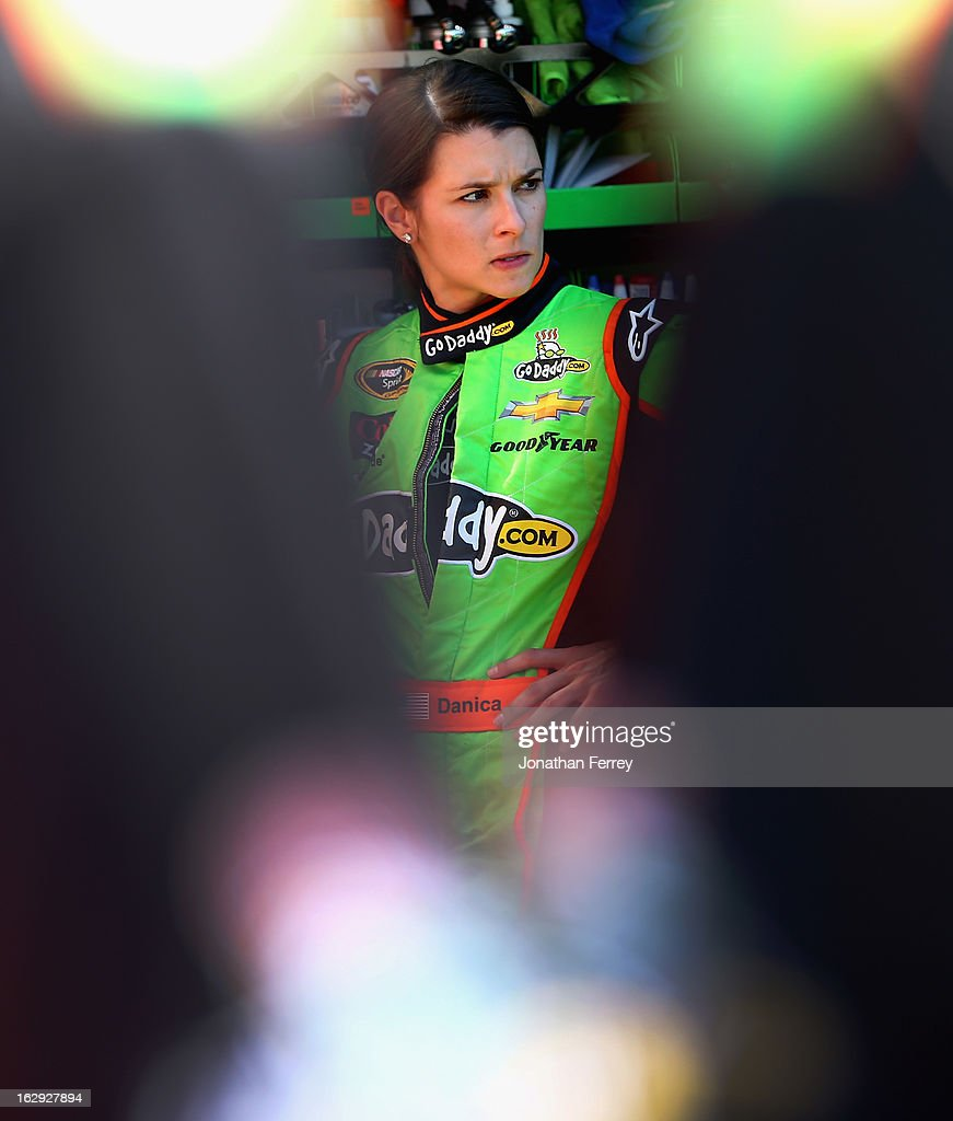 Danica Patrick, driver of the #10 GoDaddy.com Chevrolet, stands by her car in the garage area during practice for the NASCAR Sprint Cup Series Subway Fresh Fit 500 at Phoenix International Raceway on March 1, 2013 in Avondale, Arizona.