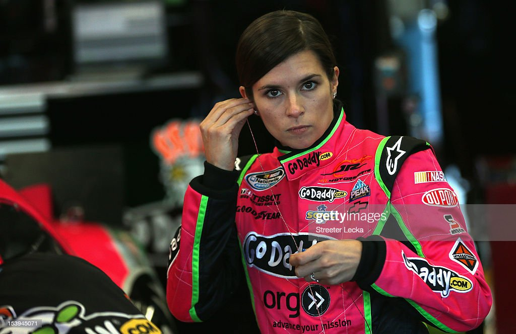 <a gi-track='captionPersonalityLinkClicked' href=/galleries/search?phrase=Danica+Patrick&family=editorial&specificpeople=183352 ng-click='$event.stopPropagation()'>Danica Patrick</a>, driver of the #7 GoDaddy.com Chevrolet, stands in the garage area during practice for the NASCAR Nationwide Series Dollar General 300 at Charlotte Motor Speedway on October 11, 2012 in Charlotte, North Carolina.