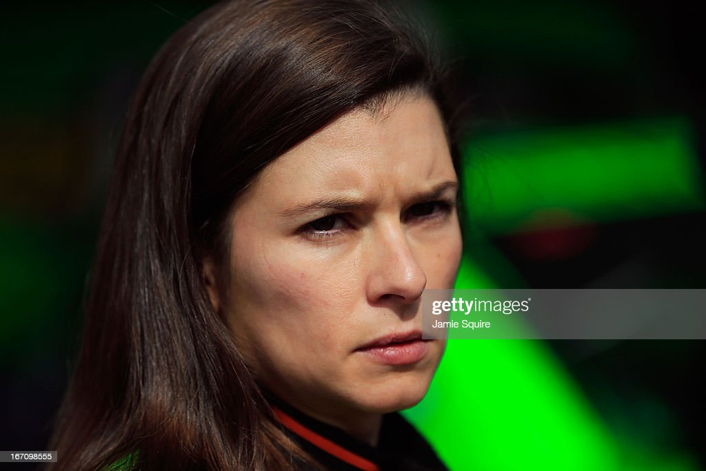 <a gi-track='captionPersonalityLinkClicked' href=/galleries/search?phrase=Danica+Patrick&family=editorial&specificpeople=183352 ng-click='$event.stopPropagation()'>Danica Patrick</a>, driver of the #10 GoDaddy.com Chevrolet, stands in the garage area during practice for the NASCAR Sprint Cup Series STP 400 at Kansas Speedway on April 20, 2013 in Kansas City, Kansas.
