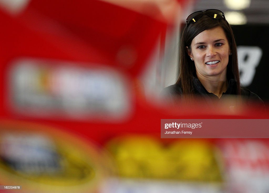 Danica Patrick, driver of the #10 GoDaddy.com Chevrolet, stands in the garage during practice for the NASCAR Sprint Cup Series Daytona 500 at Daytona International Speedway on February 20, 2013 in Daytona Beach, Florida.
