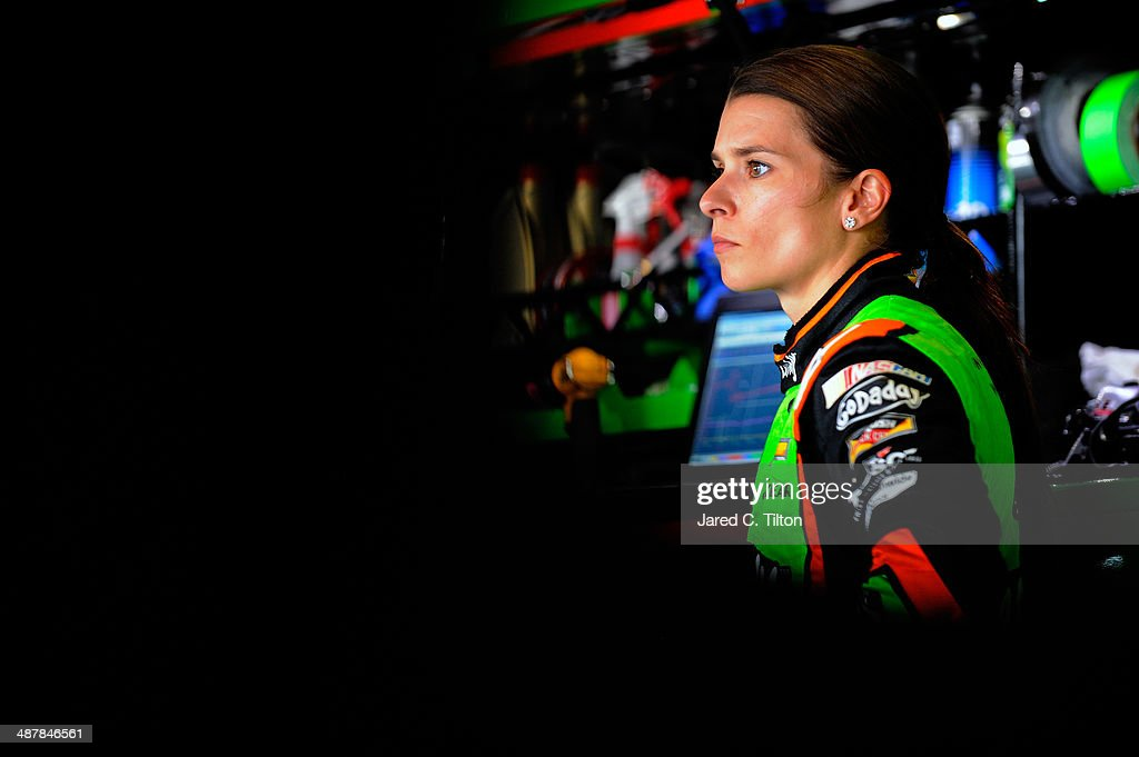 <a gi-track='captionPersonalityLinkClicked' href=/galleries/search?phrase=Danica+Patrick&family=editorial&specificpeople=183352 ng-click='$event.stopPropagation()'>Danica Patrick</a>, driver of the #10 GoDaddy.com Chevrolet, stands in the garage during practice for the NASCAR Sprint Cup Series Aaron's 499 at Talladega Superspeedway on May 2, 2014 in Talladega, Alabama.