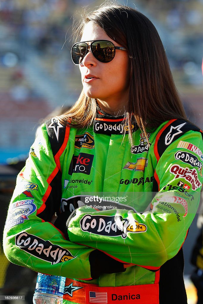 Danica Patrick, driver of the #10 GoDaddy.com Chevrolet, stands near her car during qualifying for the NASCAR Sprint Cup Series Subway Fresh Fit 500 at Phoenix International Raceway on March 1, 2013 in Avondale, Arizona.