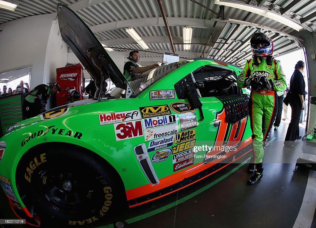 <a gi-track='captionPersonalityLinkClicked' href=/galleries/search?phrase=Danica+Patrick&family=editorial&specificpeople=183352 ng-click='$event.stopPropagation()'>Danica Patrick</a>, driver of the #10 GoDaddy.com Chevrolet, stands next to her car in the garage area during practice for the NASCAR Sprint Cup Series Daytona 500 at Daytona International Speedway on February 20, 2013 in Daytona Beach, Florida.