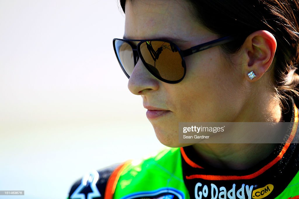 <a gi-track='captionPersonalityLinkClicked' href=/galleries/search?phrase=Danica+Patrick&family=editorial&specificpeople=183352 ng-click='$event.stopPropagation()'>Danica Patrick</a>, driver of the #7 GoDaddy.com Chevrolet, stands on pit road during qualifying for the NASCAR Nationwide Series Virginia 529 College Savings 250 at Richmond International Raceway on September 7, 2012 in Richmond, Virginia.
