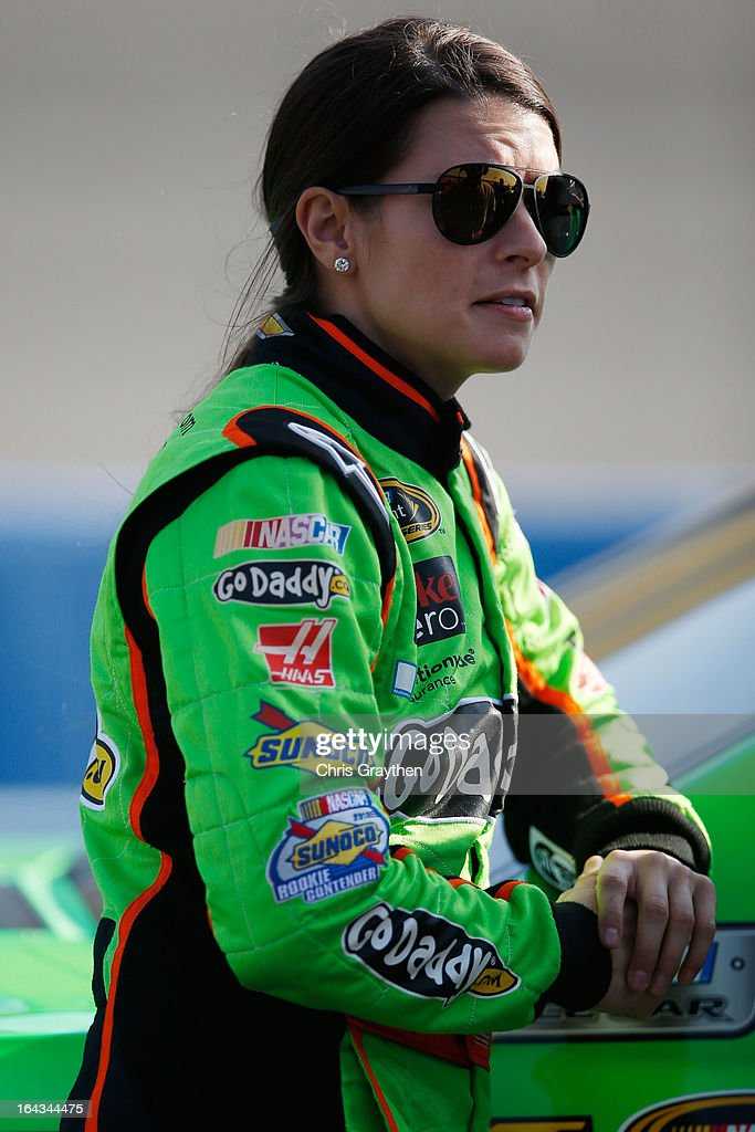 <a gi-track='captionPersonalityLinkClicked' href=/galleries/search?phrase=Danica+Patrick&family=editorial&specificpeople=183352 ng-click='$event.stopPropagation()'>Danica Patrick</a>, driver of the #10 GoDaddy.com Chevrolet, stands on the grid during qualifying for the NASCAR Sprint Cup Series Auto Club 400 at Auto Club Speedway on March 22, 2013 in Fontana, California.