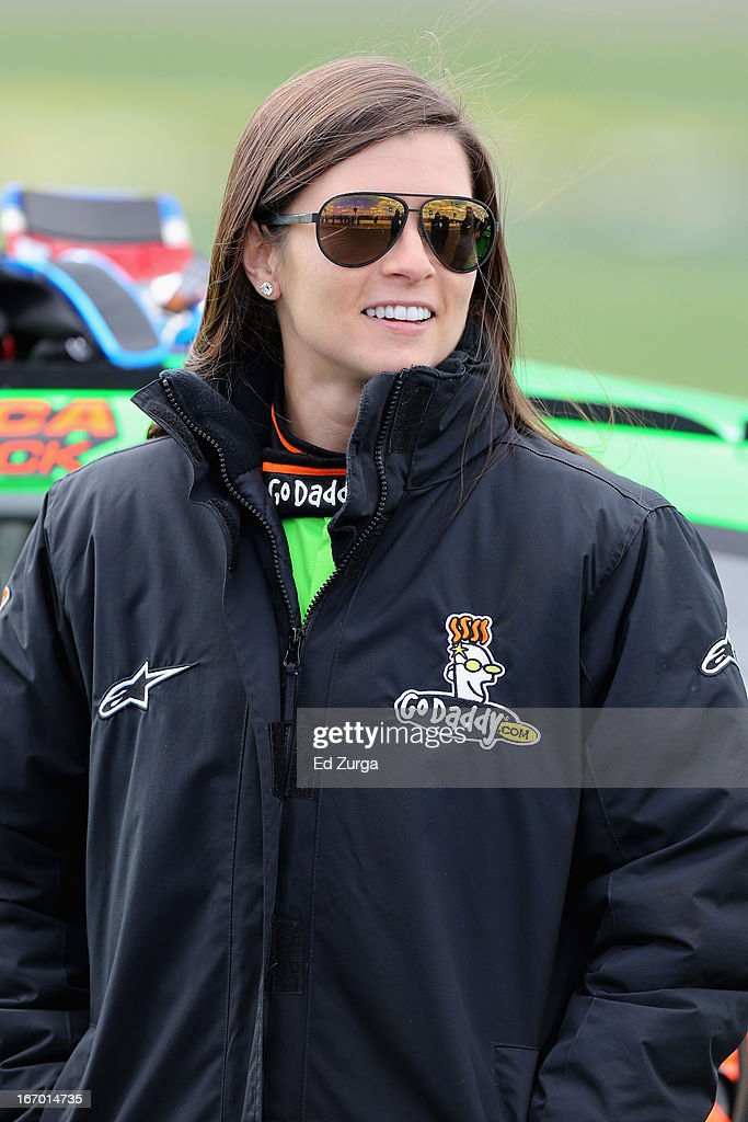 Danica Patrick, driver of the #10 GoDaddy.com Chevrolet, stands on the grid during qualifying for the NASCAR Sprint Cup Series STP 400 at Kansas Speedway on April 19, 2013 in Kansas City, Kansas.