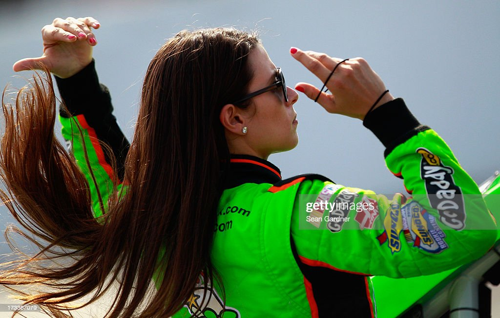 <a gi-track='captionPersonalityLinkClicked' href=/galleries/search?phrase=Danica+Patrick&family=editorial&specificpeople=183352 ng-click='$event.stopPropagation()'>Danica Patrick</a>, driver of the #10 GoDaddy.com Chevrolet, stands on the grid during qualifying for the NASCAR Sprint Cup Series Camping World RV Sales 301 at New Hampshire Motor Speedway on July 12, 2013 in Loudon, New Hampshire.