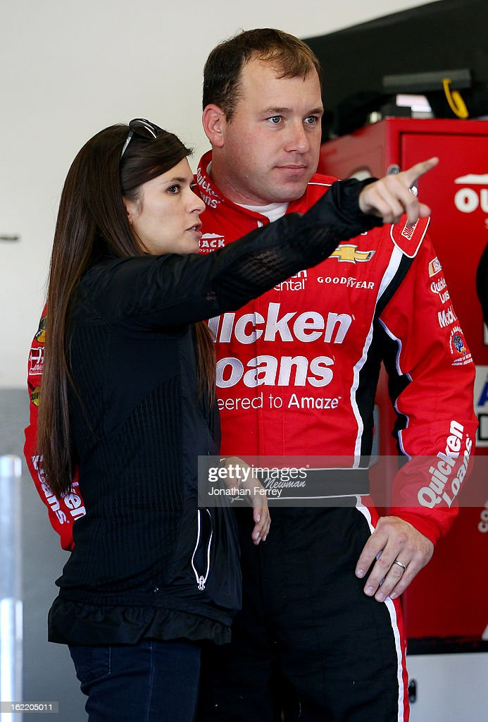 Danica Patrick (L), driver of the #10 GoDaddy.com Chevrolet, talks Ryan Newman (R), driver of the #39 Quicken Loans Chevrolet, in the garage during practice for the NASCAR Sprint Cup Series Daytona 500 at Daytona International Speedway on February 20, 2013 in Daytona Beach, Florida.
