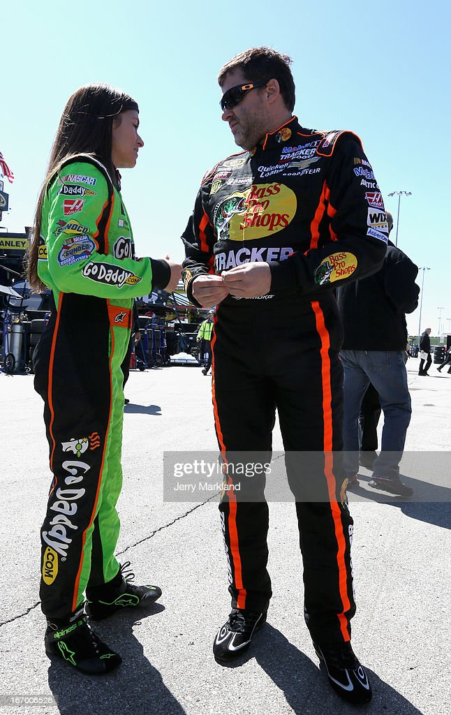 Danica Patrick, driver of the #10 GoDaddy.com Chevrolet, talks to Tony Stewart, driver of the #14 Bass Pro Shops / Mobil 1 Chevrolet, in the garage area during practice for the NASCAR Sprint Cup Series STP 400 at Kansas Speedway on April 19, 2013 in Kansas City, Kansas.