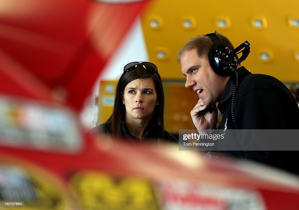 Danica Patrick, driver of the #10 GoDaddy.com Chevrolet, talks with a crew member in the garage during practice for the NASCAR Sprint Cup Series Daytona 500 at Daytona International Speedway on February 20, 2013 in Daytona Beach, Florida.