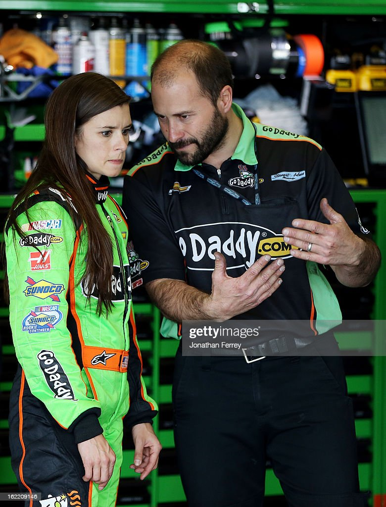 <a gi-track='captionPersonalityLinkClicked' href=/galleries/search?phrase=Danica+Patrick&family=editorial&specificpeople=183352 ng-click='$event.stopPropagation()'>Danica Patrick</a>, driver of the #10 GoDaddy.com Chevrolet, talks with crew members in the garage during practice for the NASCAR Sprint Cup Series Daytona 500 at Daytona International Speedway on February 20, 2013 in Daytona Beach, Florida.