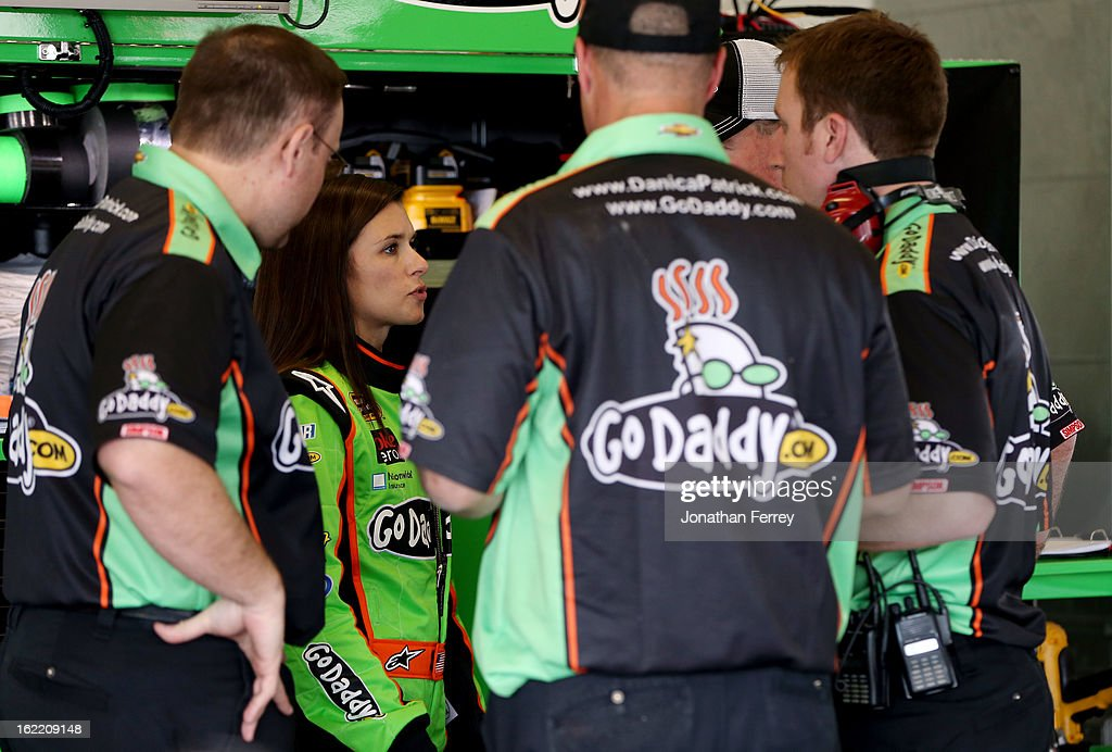 Danica Patrick, driver of the #10 GoDaddy.com Chevrolet, talks with crew members in the garage during practice for the NASCAR Sprint Cup Series Daytona 500 at Daytona International Speedway on February 20, 2013 in Daytona Beach, Florida.