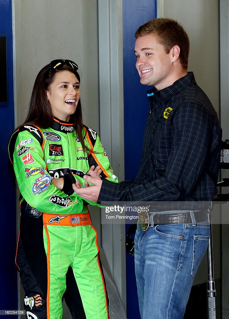 <a gi-track='captionPersonalityLinkClicked' href=/galleries/search?phrase=Danica+Patrick&family=editorial&specificpeople=183352 ng-click='$event.stopPropagation()'>Danica Patrick</a> (L), driver of the #34 GoDaddy.com Chevrolet, talks with Cup Series <a gi-track='captionPersonalityLinkClicked' href=/galleries/search?phrase=Ricky+Stenhouse+Jr.&family=editorial&specificpeople=5380612 ng-click='$event.stopPropagation()'>Ricky Stenhouse Jr.</a> (R), driver of the #17 Best Buy Ford, in the garage during practice for the NASCAR Nationwide Series DRIVE4COPD 300 at Daytona International Speedway on February 21, 2013 in Daytona Beach, Florida.