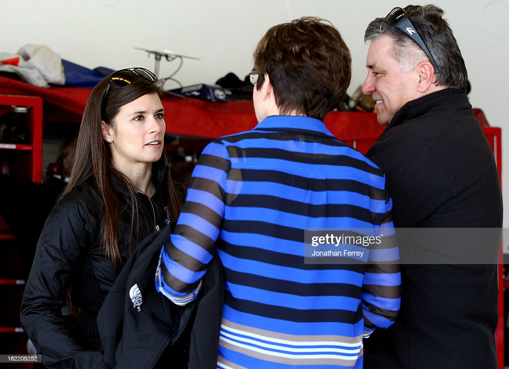 Danica Patrick (L), driver of the #10 GoDaddy.com Chevrolet, talks with her parents T.J. (R) and Bev (C) in the garage during practice for the NASCAR Sprint Cup Series Daytona 500 at Daytona International Speedway on February 20, 2013 in Daytona Beach, Florida.