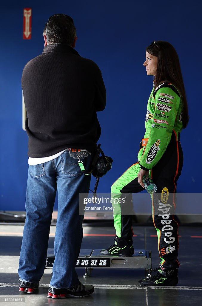 <a gi-track='captionPersonalityLinkClicked' href=/galleries/search?phrase=Danica+Patrick&family=editorial&specificpeople=183352 ng-click='$event.stopPropagation()'>Danica Patrick</a> (R), driver of the #34 GoDaddy.com Chevrolet, talks with her father T.J. (L) in the garage during practice for the NASCAR Nationwide Series DRIVE4COPD 300 at Daytona International Speedway on February 21, 2013 in Daytona Beach, Florida.