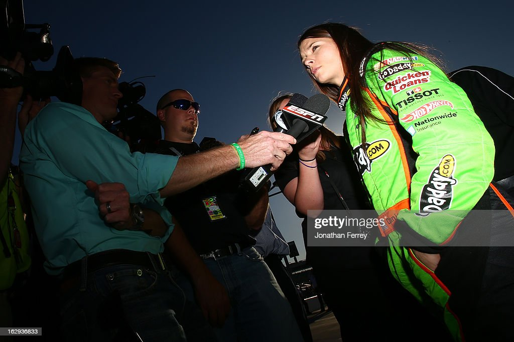 <a gi-track='captionPersonalityLinkClicked' href=/galleries/search?phrase=Danica+Patrick&family=editorial&specificpeople=183352 ng-click='$event.stopPropagation()'>Danica Patrick</a>, driver of the #10 GoDaddy.com Chevrolet, talks with members of the media during qualifying for the NASCAR Sprint Cup Series Subway Fresh Fit 500 at Phoenix International Raceway on March 1, 2013 in Avondale, Arizona.
