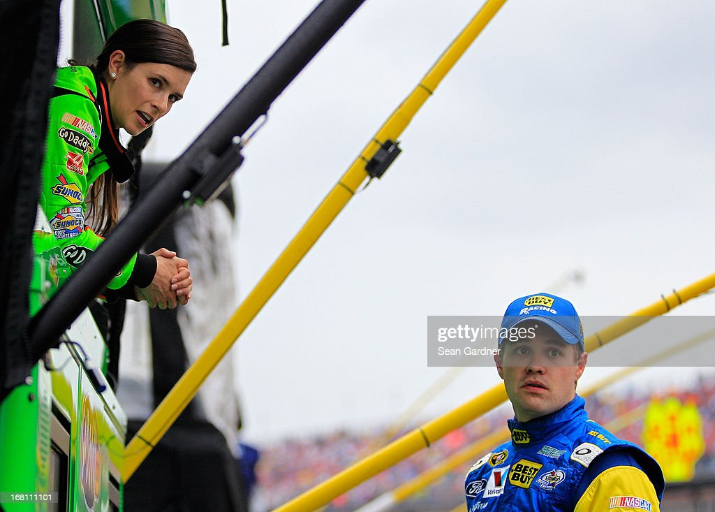 <a gi-track='captionPersonalityLinkClicked' href=/galleries/search?phrase=Danica+Patrick&family=editorial&specificpeople=183352 ng-click='$event.stopPropagation()'>Danica Patrick</a>, driver of the #10 GoDaddy.com Chevrolet talks with <a gi-track='captionPersonalityLinkClicked' href=/galleries/search?phrase=Ricky+Stenhouse+Jr.&family=editorial&specificpeople=5380612 ng-click='$event.stopPropagation()'>Ricky Stenhouse Jr.</a>, driver of the #17 Best Buy Ford, as the race was under caution due to rain during the NASCAR Sprint Cup Series Aaron's 499 at Talladega Superspeedway on May 5, 2013 in Talladega, Alabama.
