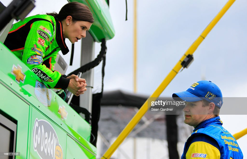 Danica Patrick, driver of the #10 GoDaddy.com Chevrolet talks with Ricky Stenhouse Jr., driver of the #17 Best Buy Ford, as the race was under caution due to rain during the NASCAR Sprint Cup Series Aaron's 499 at Talladega Superspeedway on May 5, 2013 in Talladega, Alabama.