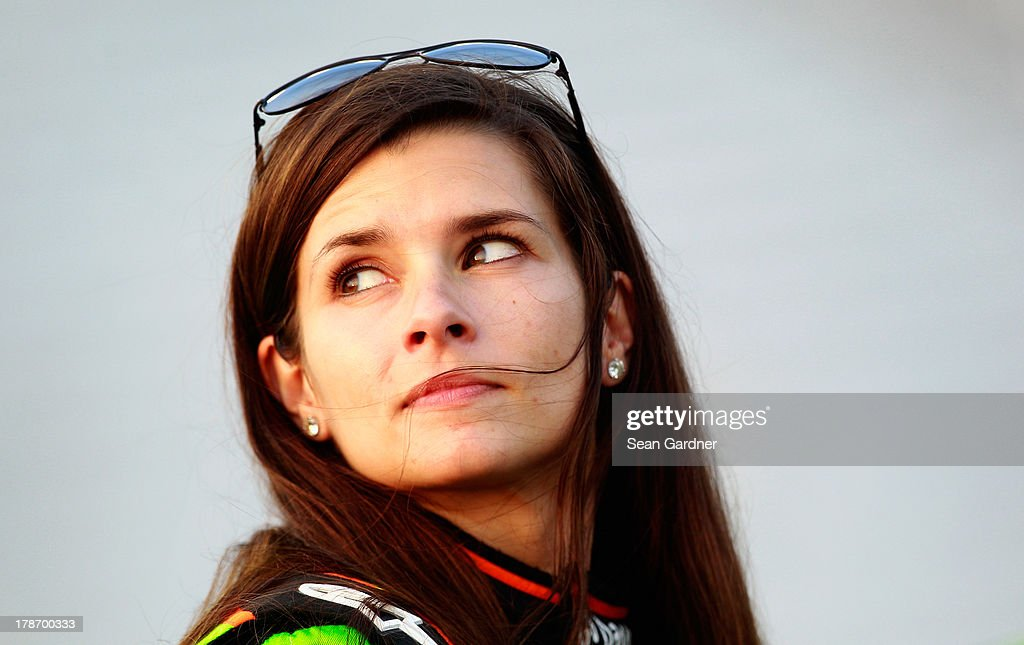 <a gi-track='captionPersonalityLinkClicked' href=/galleries/search?phrase=Danica+Patrick&family=editorial&specificpeople=183352 ng-click='$event.stopPropagation()'>Danica Patrick</a>, driver of the #10 GoDaddy.com Chevrolet, walks on pit road during qualifying for the NASCAR Sprint Cup Series AdvoCare 500 at Atlanta Motor Speedway on August 30, 2013 in Hampton, Georgia.