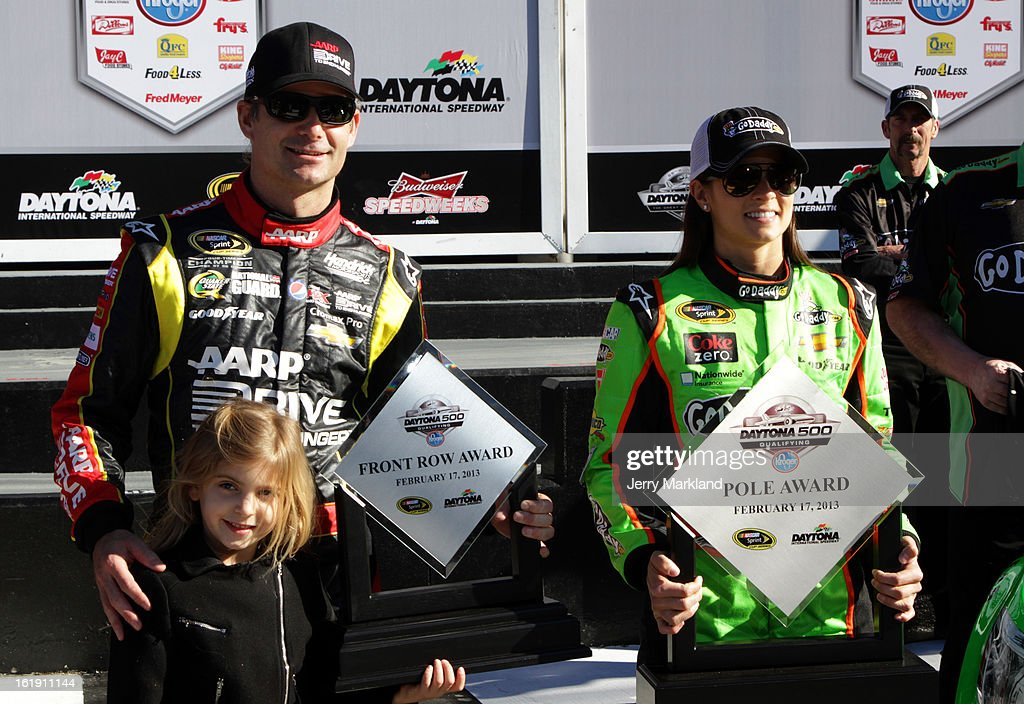 Danica Patrick, driver of the #10 GoDaddy.com Chevrolet, with her Pole Award and Jeff Gordon, driver of the #24 Drive To End Hunger Chevrolet, with his Front Row Award after qualifying for the NASCAR Sprint Cup Series Daytona 500 at Daytona International Speedway on February 17, 2013 in Daytona Beach, Florida.