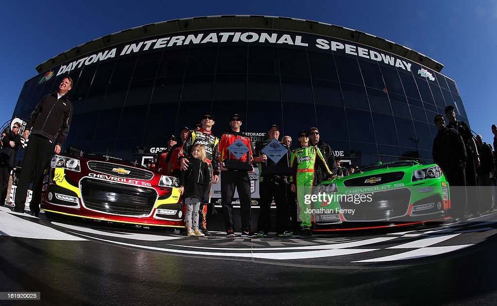 <a gi-track='captionPersonalityLinkClicked' href=/galleries/search?phrase=Danica+Patrick&family=editorial&specificpeople=183352 ng-click='$event.stopPropagation()'>Danica Patrick</a>, driver of the #10 GoDaddy.com Chevrolet, with her Pole Award and <a gi-track='captionPersonalityLinkClicked' href=/galleries/search?phrase=Jeff+Gordon&family=editorial&specificpeople=171491 ng-click='$event.stopPropagation()'>Jeff Gordon</a>, driver of the #24 Drive To End Hunger Chevrolet, with his Front Row Award after qualifying for the NASCAR Sprint Cup Series Daytona 500 at Daytona International Speedway on February 17, 2013 in Daytona Beach, Florida.