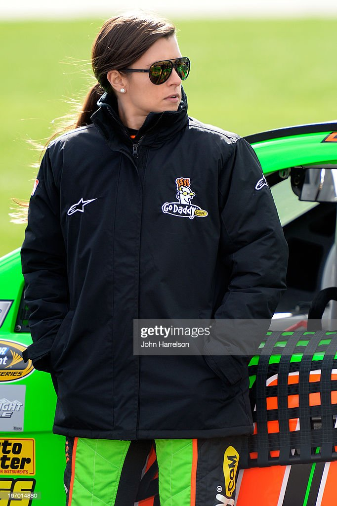Danica Patrick, driver of the #10 GoDaddy.com Chevrolet,stands on pit road during qualifying for the NASCAR Sprint Cup Series STP 400 at Kansas Speedway on April 19, 2013 in Kansas City, Kansas.