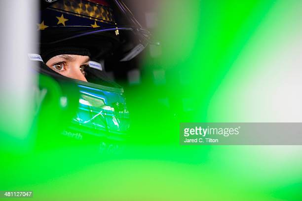 Danica Patrick driver of the GoDaddycom Get Found Chevrolet sits in her car in the garage area during practice for the NASCAR Sprint Cup Series STP...