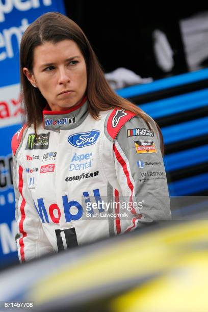 Danica Patrick driver of the Mobil 1 Annual Protection Ford stands in the garage area during practice for the Monster Energy NASCAR Cup Series Food...