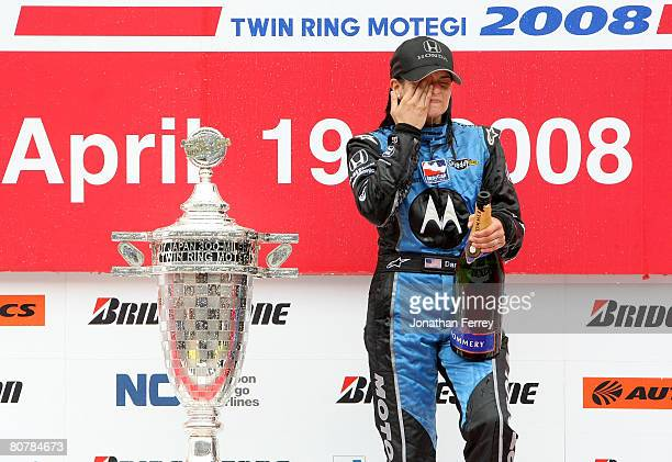 Danica Patrick driver of the Motorola Andretti Green Racing Honda Dallara wipes champagne from her eyes after winning the IndyCar Series Bridgestone...