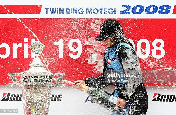 Danica Patrick driver of the Motorola Andretti Green Racing Honda Dallara sprays champagne after winning the IndyCar Series Bridgestone Indy Japan...