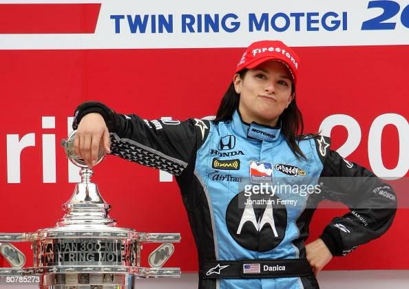 Danica Patrick driver of the Motorola Andretti Green Racing Honda Dallara poses with the trophy after winning the IndyCar Series Bridgestone Indy...