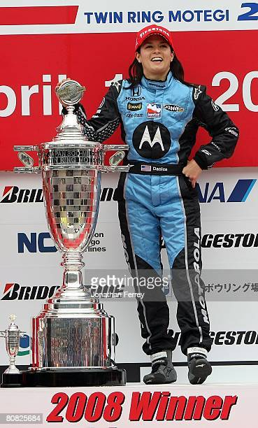 Danica Patrick driver of the Motorola Andretti Green Racing Honda Dallara poses with the trophy after winning the IndyCar Series Bridgestone Indy...