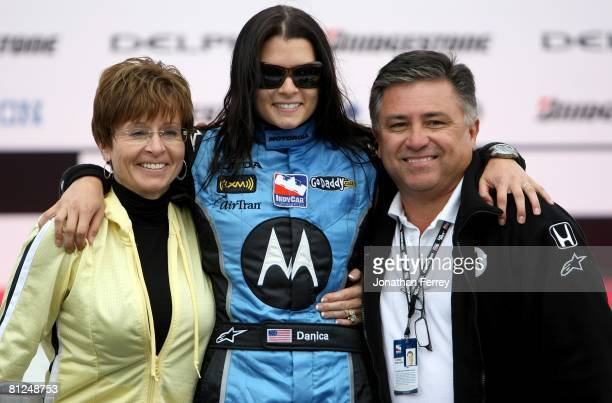 Danica Patrick driver of the Motorola Andretti Green Racing Honda Dallara poses with here parents after winning the IndyCar Series Bridgestone Indy...