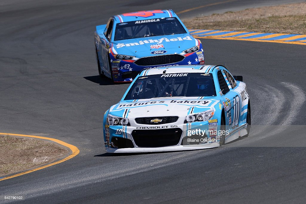 <a gi-track='captionPersonalityLinkClicked' href=/galleries/search?phrase=Danica+Patrick&family=editorial&specificpeople=183352 ng-click='$event.stopPropagation()'>Danica Patrick</a>, driver of the #10 Nature's Bakery Chevrolet, and <a gi-track='captionPersonalityLinkClicked' href=/galleries/search?phrase=Aric+Almirola&family=editorial&specificpeople=574878 ng-click='$event.stopPropagation()'>Aric Almirola</a>, driver of the #43 Smithfield Ford, practice for the NASCAR Sprint Cup Series Toyota/Save Mart 350 at Sonoma Raceway on June 24, 2016 in Sonoma, California.