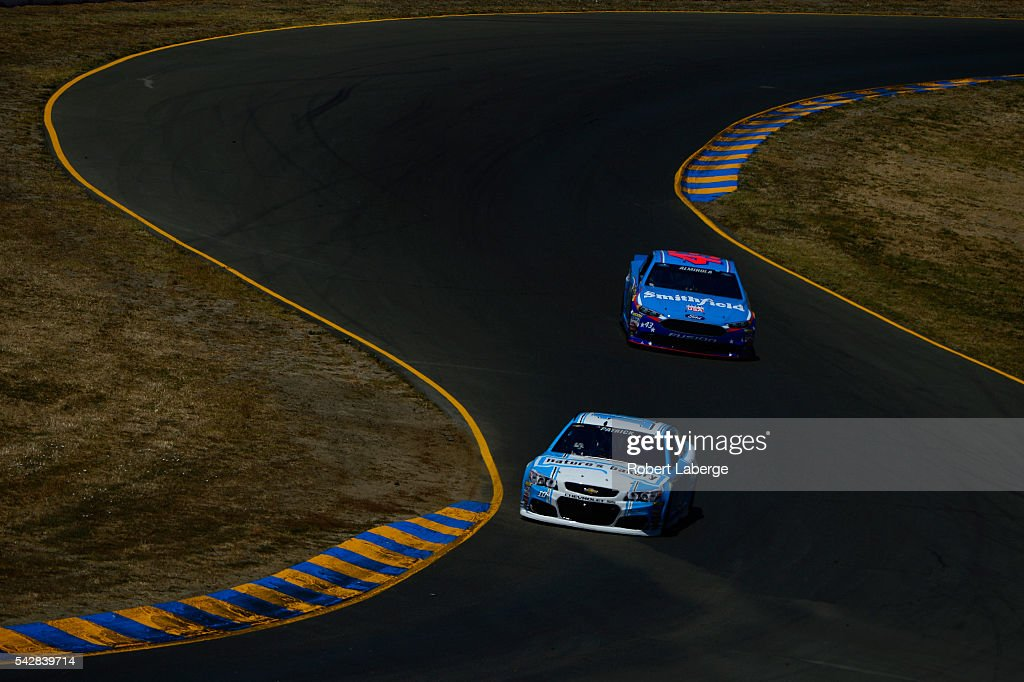 <a gi-track='captionPersonalityLinkClicked' href=/galleries/search?phrase=Danica+Patrick&family=editorial&specificpeople=183352 ng-click='$event.stopPropagation()'>Danica Patrick</a>, driver of the #10 Nature's Bakery Chevrolet, and <a gi-track='captionPersonalityLinkClicked' href=/galleries/search?phrase=Aric+Almirola&family=editorial&specificpeople=574878 ng-click='$event.stopPropagation()'>Aric Almirola</a>, driver of the #43 Smithfield Ford, drive during practice for the NASCAR Sprint Cup Series Toyota/Save Mart 350 at Sonoma Raceway on June 24, 2016 in Sonoma, California.