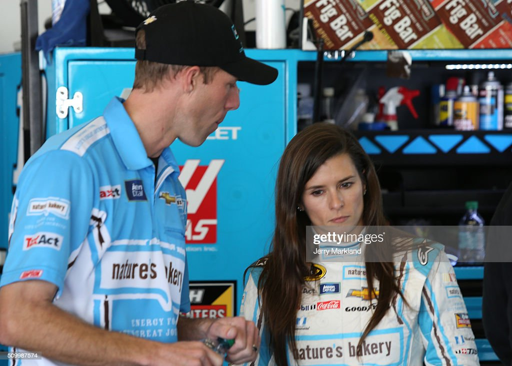 <a gi-track='captionPersonalityLinkClicked' href=/galleries/search?phrase=Danica+Patrick&family=editorial&specificpeople=183352 ng-click='$event.stopPropagation()'>Danica Patrick</a>, driver of the #10 Nature's Bakery Chevrolet, and crew chief Billy Scott look on in the garage area during practice for the NASCAR Sprint Cup Series Daytona 500 at Daytona International Speedway on February 13, 2016 in Daytona Beach, Florida.