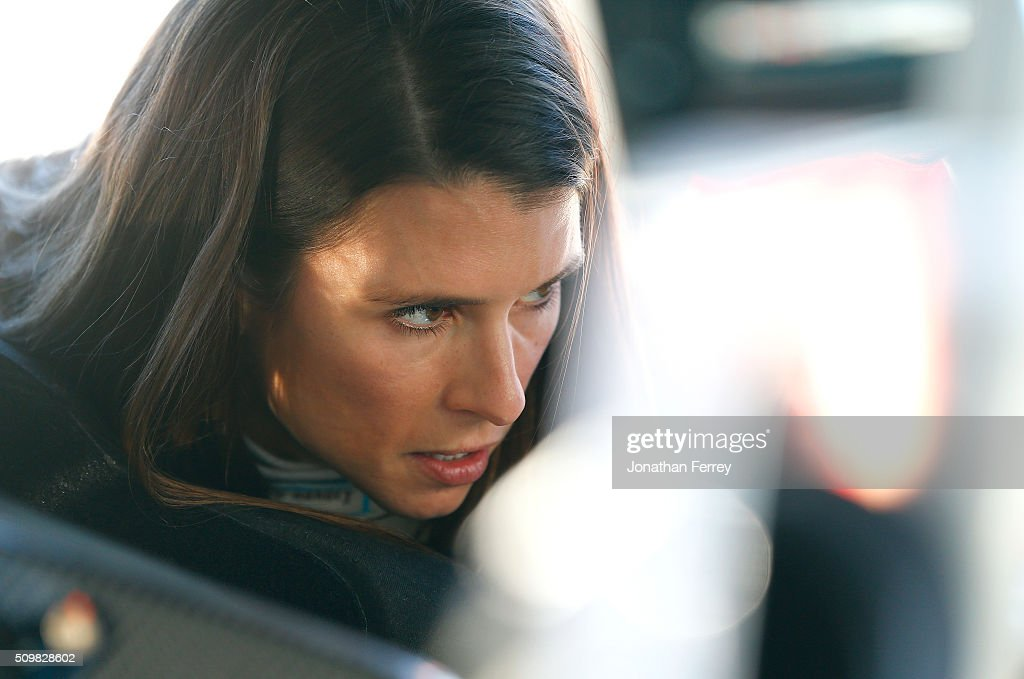 <a gi-track='captionPersonalityLinkClicked' href=/galleries/search?phrase=Danica+Patrick&family=editorial&specificpeople=183352 ng-click='$event.stopPropagation()'>Danica Patrick</a>, driver of the #10 Nature's Bakery Chevrolet, looks on in the garage area during practice for the NASCAR Sprint Cup Series Sprint Unlimited at Daytona International Speedway on February 12, 2016 in Daytona Beach, Florida.