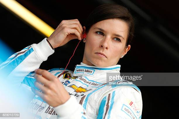 Danica Patrick driver of the Nature's Bakery Chevrolet stands in the garage area during practice for the NASCAR Sprint Cup Series TOYOTA OWNERS 400...