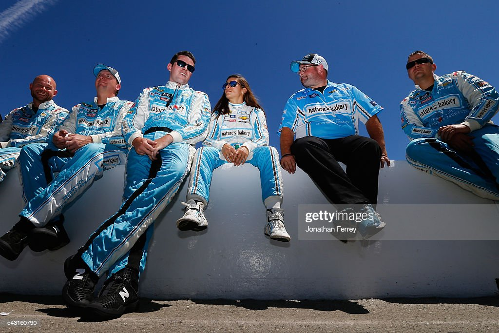 Danica Patrick, driver of the #10 Nature's Bakery Chevrolet, waits with her team prior to the NASCAR Sprint Cup Series Toyota/Save Mart 350 at Sonoma Raceway on June 26, 2016 in Sonoma, California.